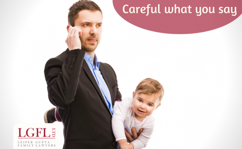 Man holding child and talking on phone