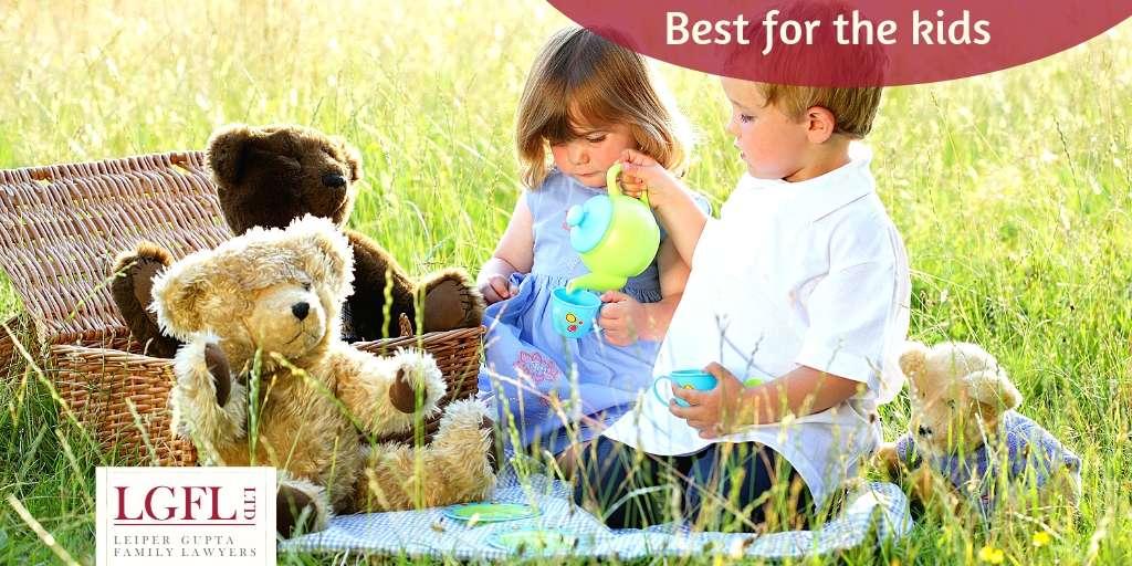 Children having tea with teddies
