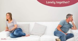 man and woman separated on sofa - unhappy marriage